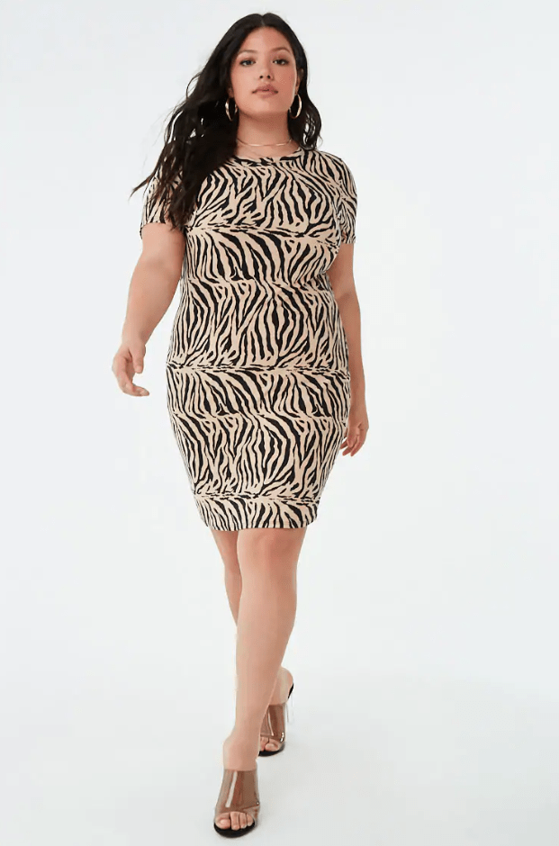 f4cbf559894 A zebra print t-shirt dress that proves style and comfort go together like  two peas in a pod. You could sleep in this