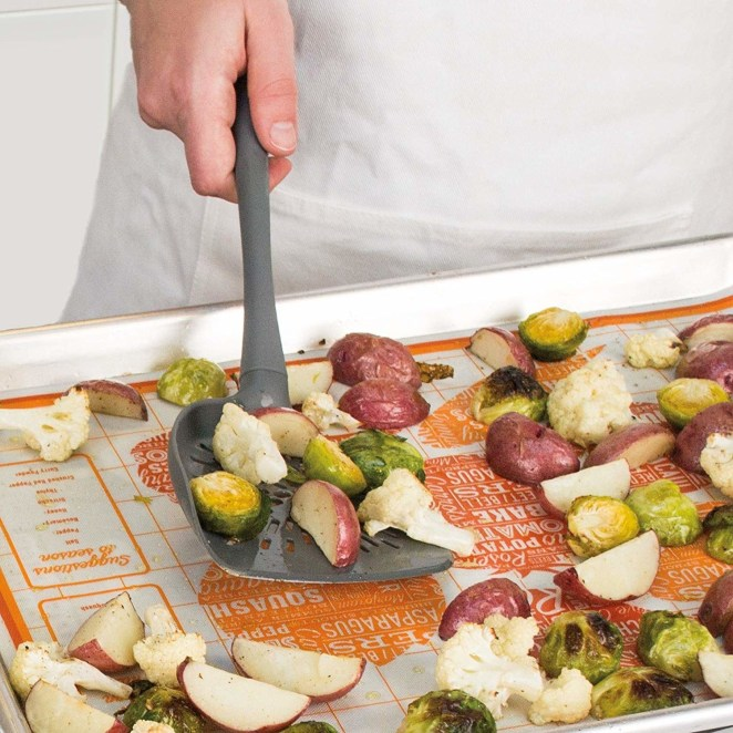 """Promising review: """"I broke this in hard with a huge batch of roasted vegetables for Thanksgiving. Brussels sprouts, potatoes, leeks, garlic, butternut squash, carrots, and more filling up a whole roasting pan. This was great for mixing, coating and turning the vegetables and incredibly effective and attractive for serving. It's a great length, and very substantial. I am delighted to have this as part of my kitchen collection."""" —Nicki HeskinGet it from Amazon for $5.06+ (available in four colors)."""