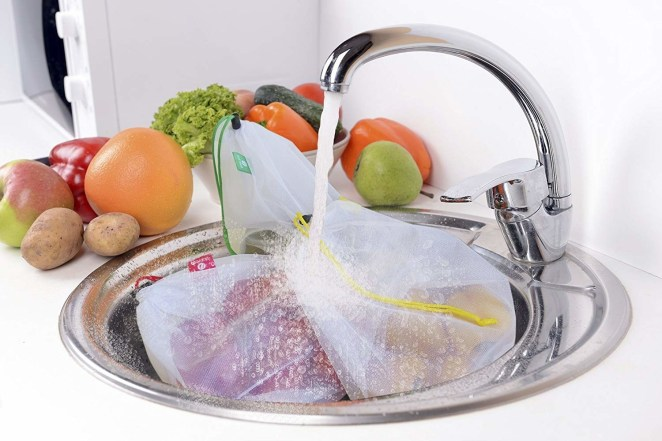 """Promising review: """"SO good, SO handy, SO ecological (without being nerdy). Simple: put grapes into one bag, tomatoes in another, green beans in another... well, you get the idea. No thin plastic bags to figure out how to open without cursing or have to dispose of. Leave these bags untied so checker has access to price, then secure the tog. These bags are plenty large enough for big heads of lettuce, tons of grapes, tomatoes, etc, and they go under your faucet for thorough rinsing. You drain the contents and put the bags directly in the fridge. They are sturdily made, close perfectly, and easy to fold and carry into a grocery store. They are exactly as shown. This is a quality product. I recommend 100%."""" —C. HascoatGet a five-pack from Amazon for $9.97."""