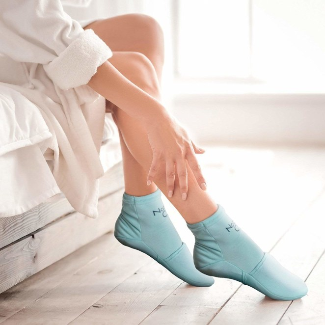 """Promising review: """"Received my ice socks yesterday after being on my feet all day. I froze them overnight (they came with gel packs inserted in the socks and instructions said to freeze them that way). I am currently resting with my feet elevated and socks on. They are very cold, especially in the toe area. I ordered these because I have a lot of swelling on the top of my right foot. The socks are made with gel-pack toe pockets, which is not the area I need the most help with, so I moved the gel pack halfway out to better cover the top of my foot and that is working well for me. These socks are very nice and well-made of a soft, comfortable, stretchy fabric. I wear a size 8.5 women's and ordered the small/medium. They were easy to put on with the gel packs inserted and a very good fit, not too small or too large. I've been wearing them for about 30 minutes and they are still fairly cold. I would highly recommend for anyone with foot problems needing ice. They're easy, convenient, and non-messy. Just what I was looking for!"""" —Texas GigiGet it from Amazon for $24.99 (available in sizes S/M and M/L)."""