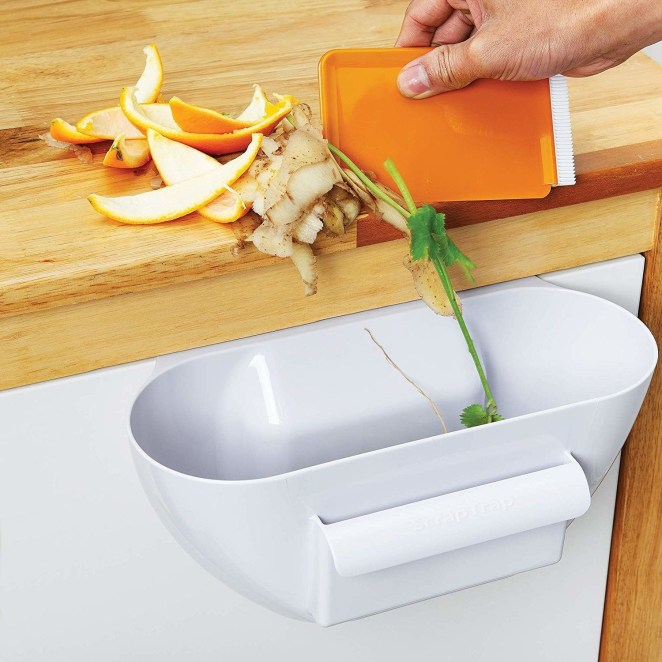 """Promising review: """"I sometimes get suckered into kitchen gadgets that I never use, but this thing is awesome! Keeps the counter clean, you can either scoop the parts you want to put in the trash into this (strawberry stems, onion peels, etc.), or you can put the parts you want to use in here to make them easier to dump into the pan (broccoli florets, chopped peppers, onions, etc.). Makes it so much easier than trying to scrape chopped veggies off the cutting board into the pan and spilling them all over. Love this thing!"""" —*BeckyC*Get it from Amazon for $14.18."""