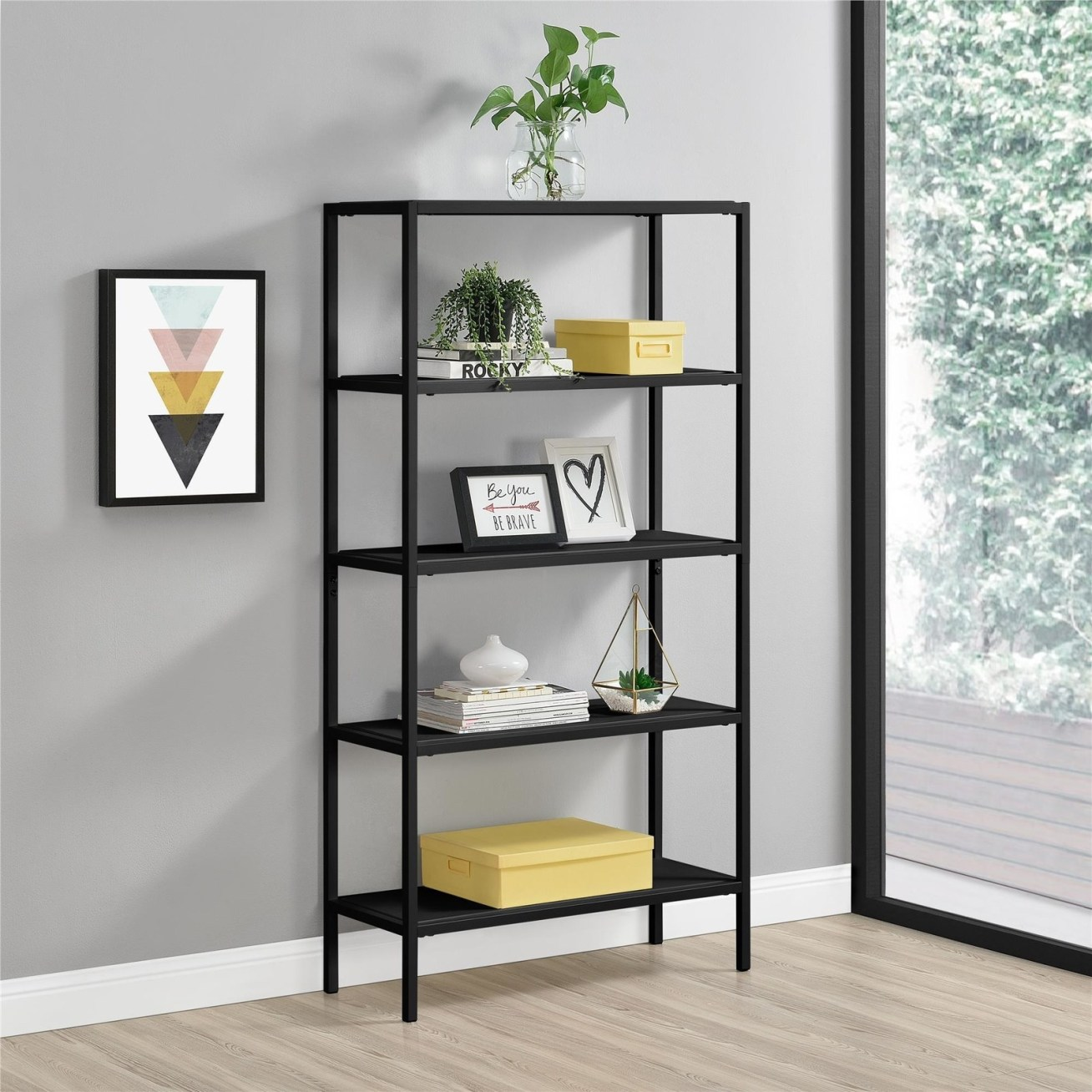 "Promising review: ""After assembling this bookcase, I am still very pleased with my selection. It has black metal posts and very dark brown wooden shelves. This bookcase is a little over 5 feet tall and about 30 inches wide. Small artwork, statues, and books would look lovely on this bookcase. A safety strap was included in the box, so the bookcase can be attached to the wall. This keeps small children safer so the bookcase cannot fall on them. This bookcase would go nicely in a study, a living room, and also in the bedroom."" —SJLee