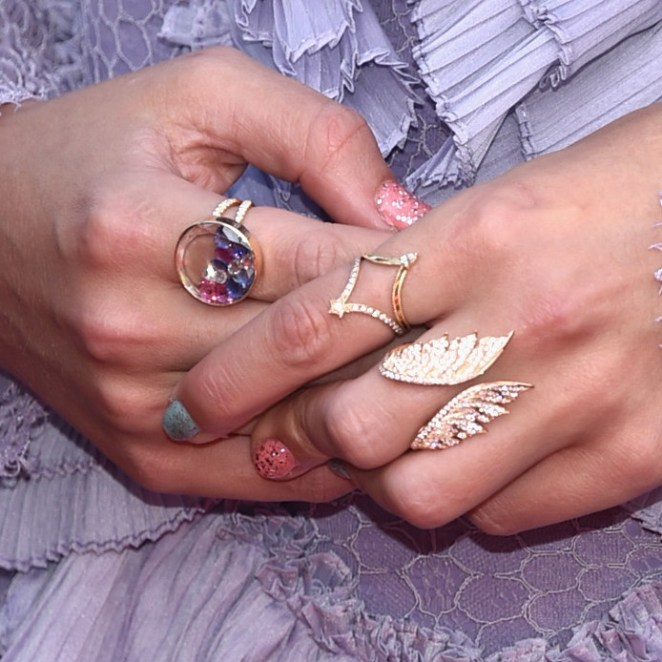The ring on Taylor's middle finger looks a lot like a bigger version of the Victoria's Secret Angel ring she wears often, and recently led fans to speculate that TS7 would have something to do with angels.