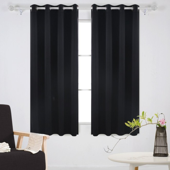 """Promising review: """"I was incredibly hesitant to purchase these curtains for a couple of reasons. First, the price seemed too good to be true. They just arrived on my doorstep and I am so pleased with them, I immediately came to write a positive review! These curtains are SOLID! The material is a heavy weight and not the slightest bit see-through. The grommets are heavy pieces of hardware that will definitely hold up to lots of use. And as a bonus, they come with ties to hold them back when you're ready to let the light in. I wish I'd found these curtains years ago."""" —C&A AllenCheck out our full review of the amazing Deconovo blackout curtains.Get it from Amazon for $21.99+ (available in various colors, and three sizes)."""