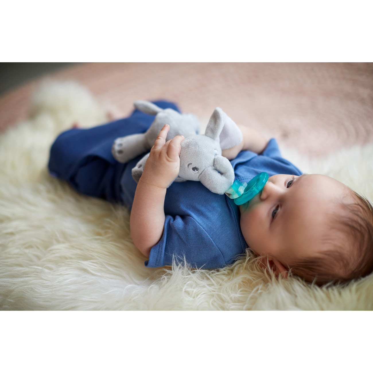 """The Soothie silicone pacifiers are especially designed to be extra comfortable for newborns up through three months, but the stuffed animal is compatible with several sizes of pacifiers. And of course it's washable!Promising review: """"My two-month-old daughter is obsessed with this Soothie and snuggle buddy. It's large enough for her to clumsily grasp and lightweight enough for her to position the pacifier back in her mouth if it falls out. I love how easy it is to detach the Soothie from the plush monkey, allowing me to clean each part separately as needed. This will also come in handy when the size of my daughter's pacifier changes or when she weans off it and can keep her snuggle buddy!"""" —Lu87Get it from Walmart for .95+ (available as an elephant or giraffe)."""