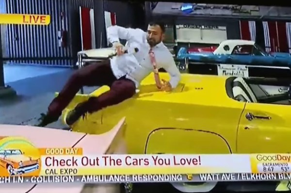 A Local TV Reporter Jumped On Cars At An Auto Show And It