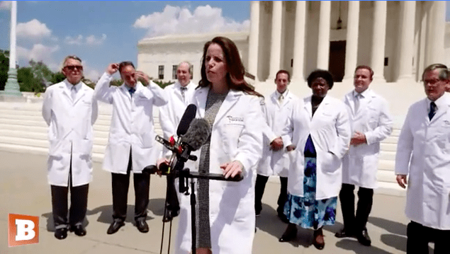 An image of people in medical gear talking in Washington as part of a video filled with coronavirus misinformation.