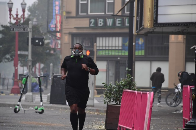 A jogger wears a respirator in downtown Portland, Oregon.