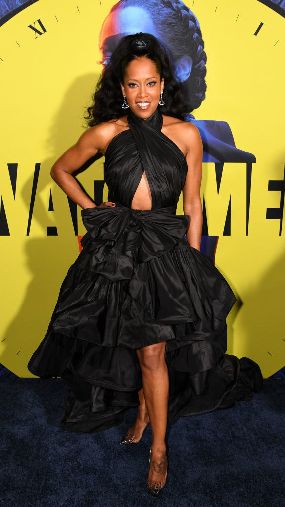 Regina King posing in front of a