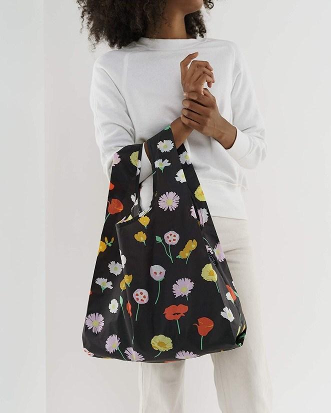 A model holds a BAGGU in desert wildflower print