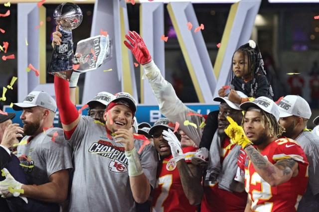 Patrick Mahomes #15 of the Kansas City Chiefs raises the Vince Lombardi Trophy