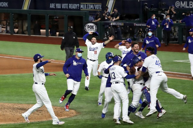 The Los Angeles Dodgers celebrate after defeating the Tampa Bay Rays 3-1 in Game Six