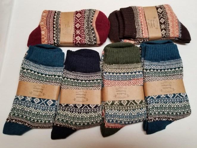 Reviewer image of six pairs of homga wool socks