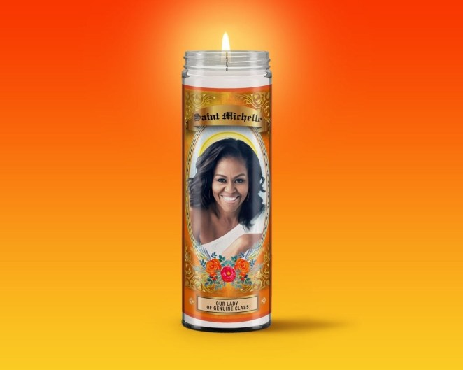 """Prayer candle with Michelle Obama's face and words """"Our Lady of Genuine Class"""""""