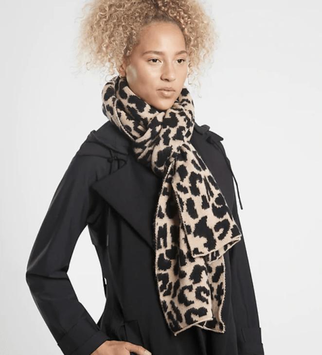 Model wears leopard print scarf with black coat