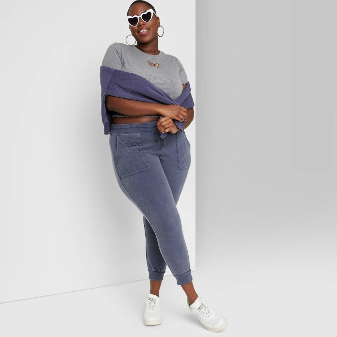 A model wearing the vintage inspired joggers