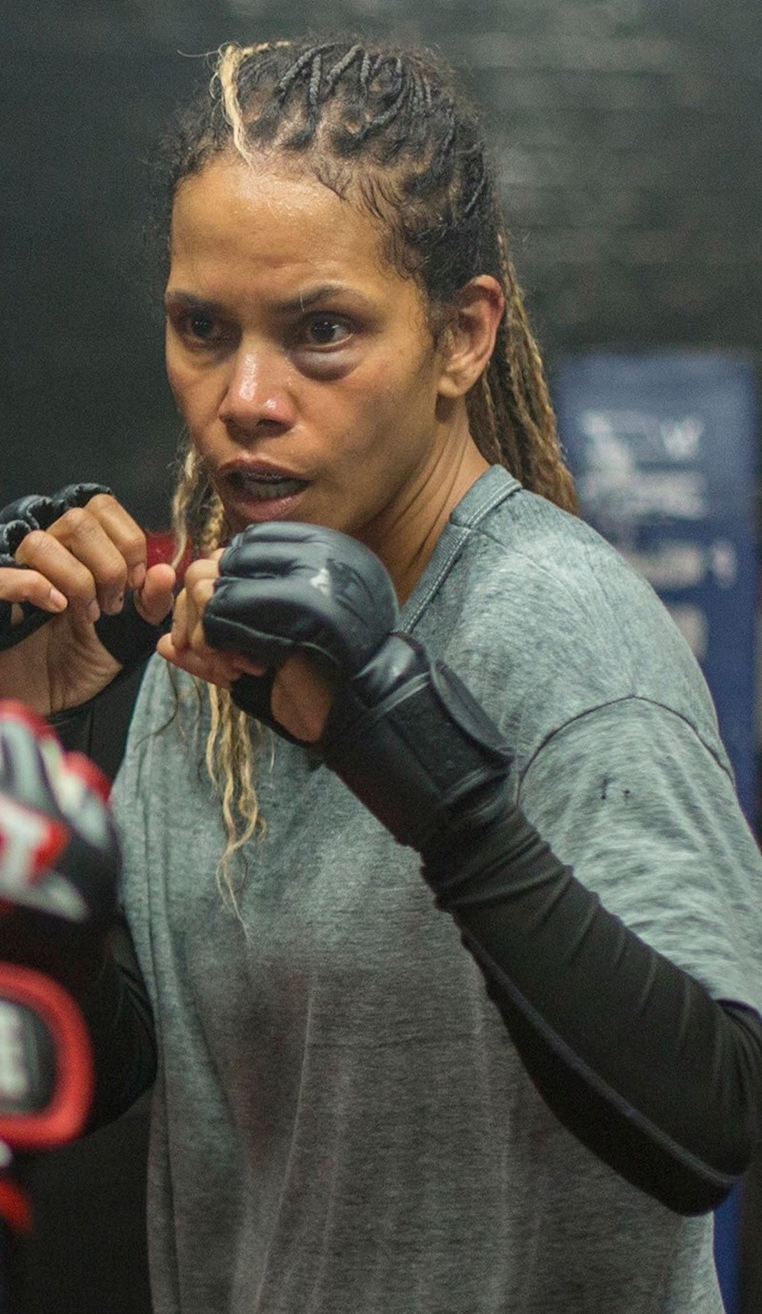Halle Berry as a boxer in the ring with her eye bruised