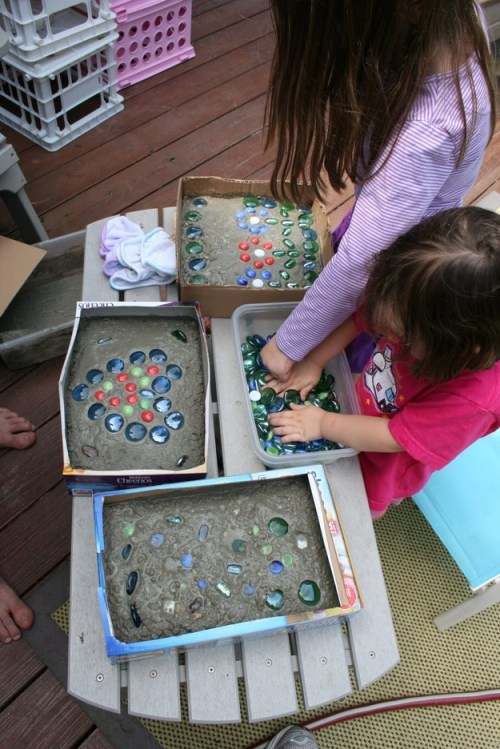 Enlist the kids to help you make stepping stones out of cement, cereal boxes, and glass stones.