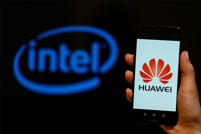 A person holds a Huawei mobile phone in front of the logo of Intel in Izmir, Turkey on May 28. Photo: VCG