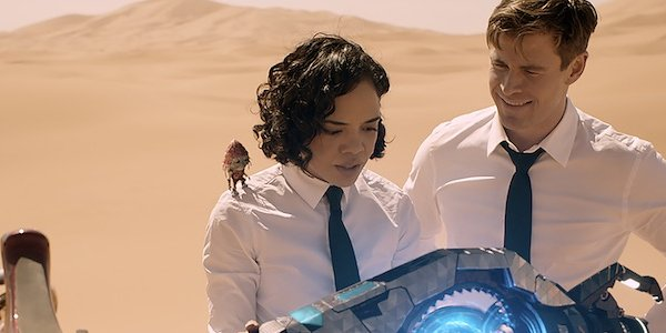 Pawny Agent M and Agent H looking at a hoverbike in Men In Black International