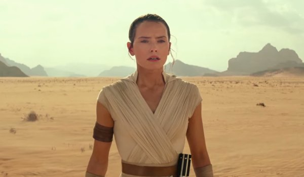 Star Wars: The Rise of Skywalker Rey stands in the desert, with a lightsaber on her belt