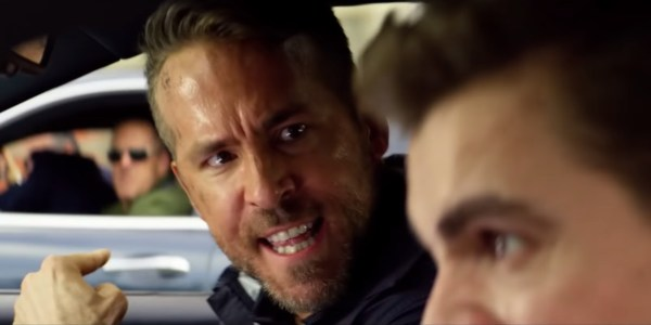 6 Underground Ryan Reynolds pointing angrily out the car window during a chase