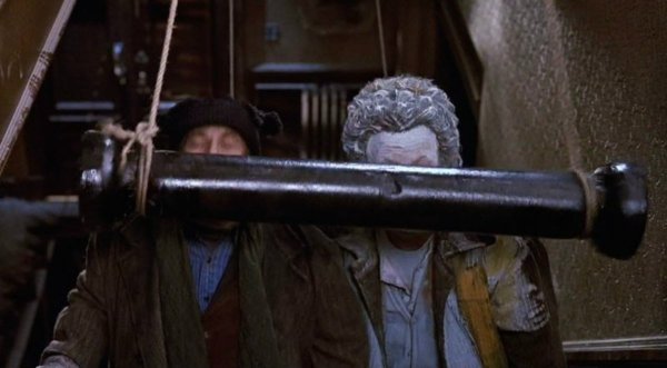 The metal bar hitting both Marv and Harry on the stairs in Home Alone 2.
