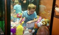 A Child Acquired Caught Inside An Arcade Claw Machine