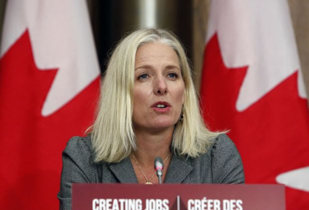 Catherine McKenna, Canada's infrastructure and communities minister, speaks during a news conference in Ottawa, Ontario, Canada, on Thursday, October 1, 2020. She is speaking in front of a sign tha...