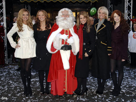 welcomed Father Christmas to Harrods. The girls posed for photographs