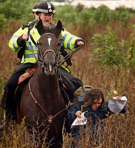 Mounted police chase a protester at BAA