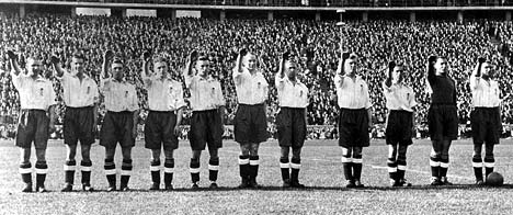 In a picture from a German archive never before published in Britain, the England football team give Nazi salutes in Berlin in 1938