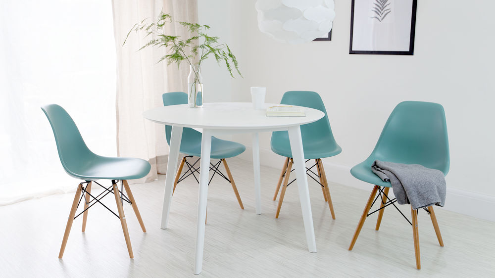 Round White Dining Table And Eames Dining Chair Set