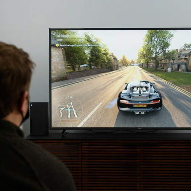 person playing video game on Vizo V-Series tv