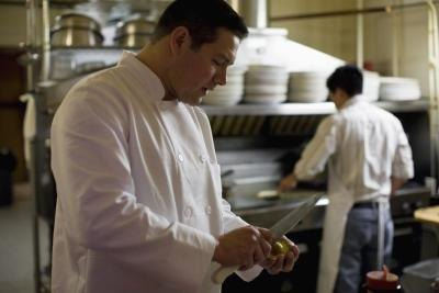 assistant cooks supporting head chef in a kitchen todd warnock