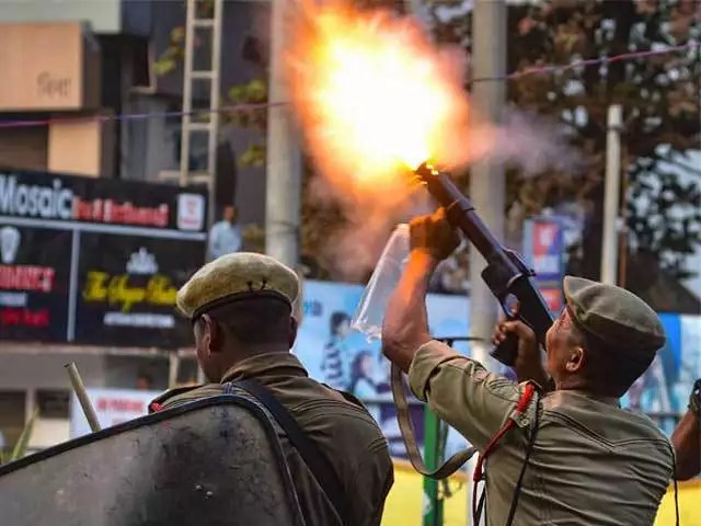 Teargas fired - CAB protests: Assam goes up in flames, people defy curfew |  The Economic Times