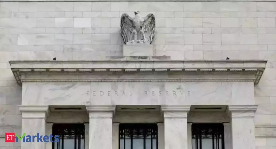 Fed strengthens view of economy while keeping rates near zero