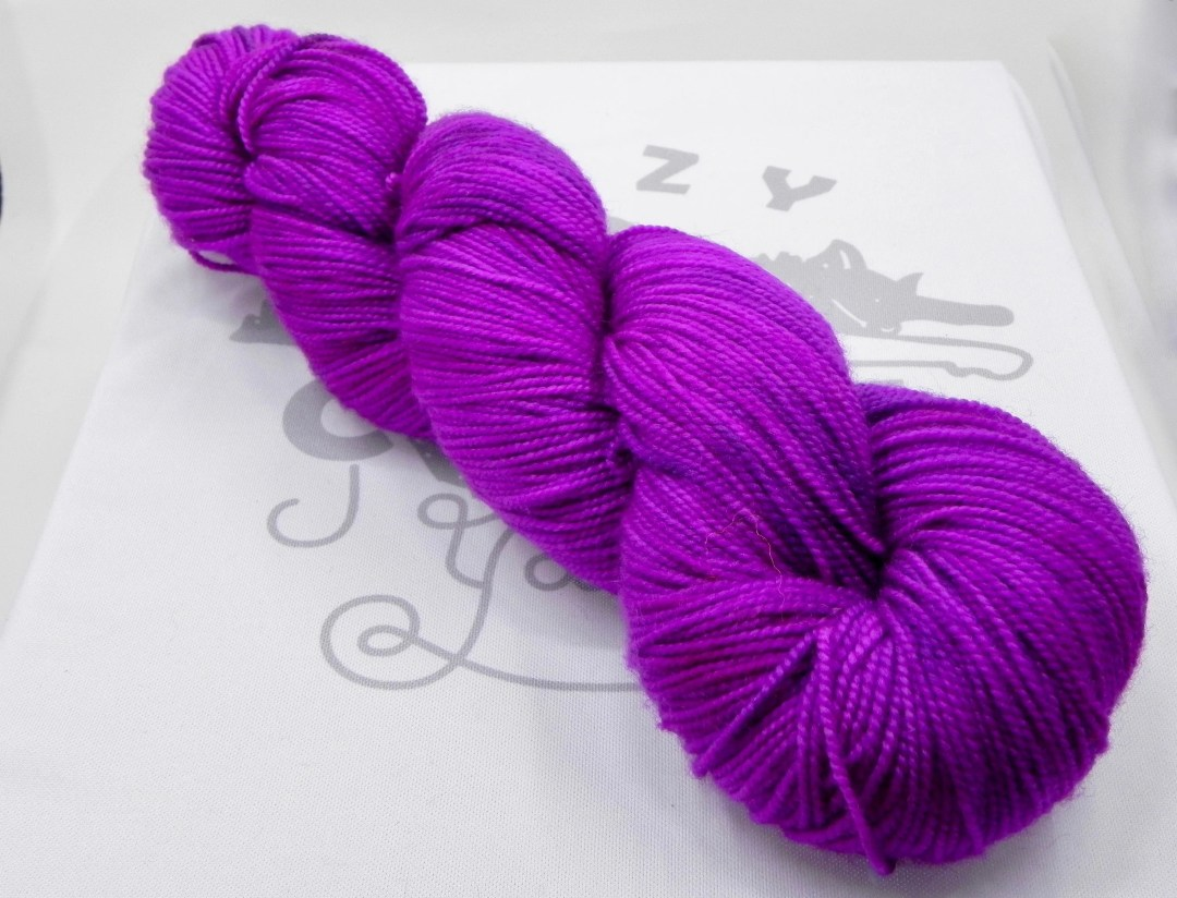 Orchid's Heart: 400 yards 100% Superwash Merino fingering weight yarn in Elemental yarn base.
