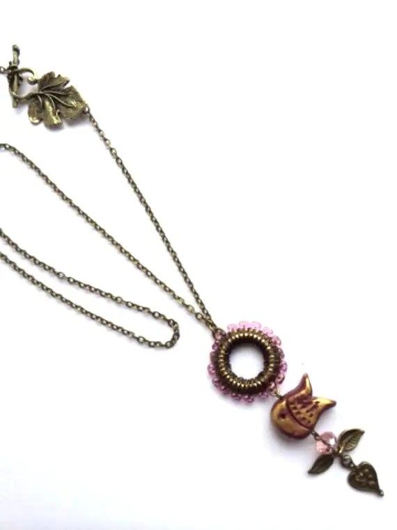 Purple and gold fish necklace