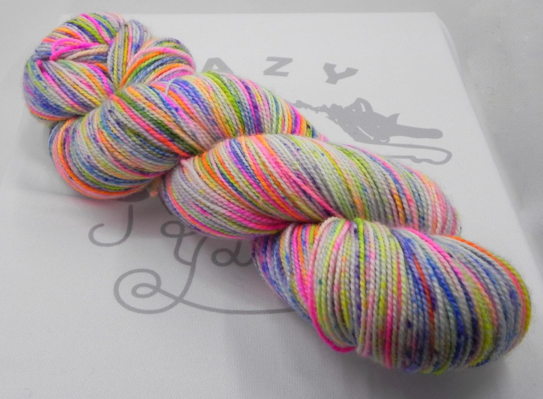 Feelin' Groovy: 400 yards 100% Superwash Merino fingering weight yarn in Elemental yarn base.