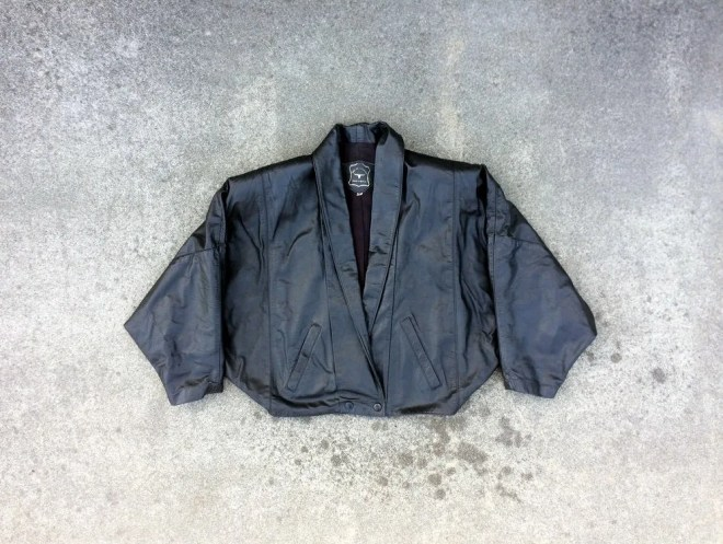 Batty -- Black leather ba...