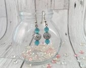 Blue and silver dangle ea...