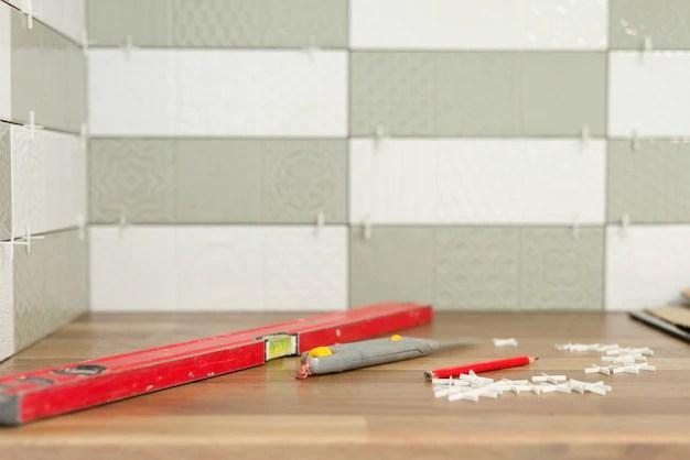 rubber hammer on the tile for better gluing