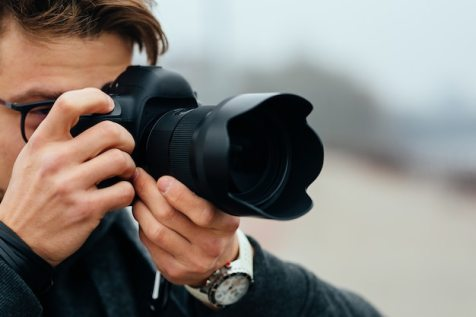 Free Photo | Close-up view of male hand holding professional camera on the street.