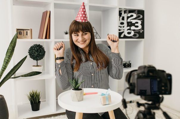 Female blogger streaming birthday with camera