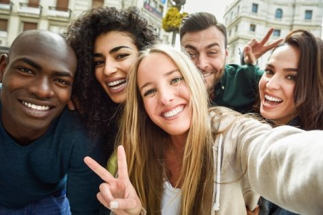 Multiracial group of young people taking selfie | Free Photo