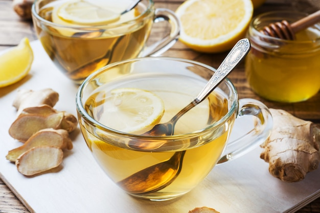 beneficii ghimbir, Free Photo | Two cup of ginger tea with lemon slice and almonds isolated on  white backdrop