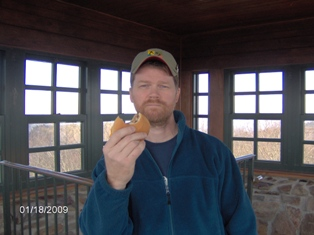 David showing off his cheeseburger inside the observation tower on the summit.