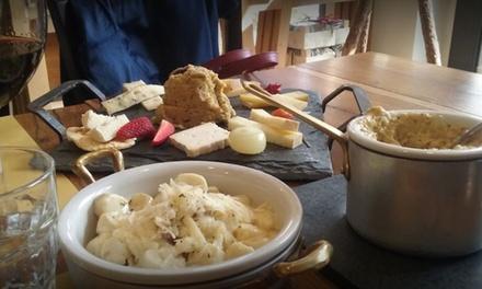 Menu degustazione formaggi con bottiglia di vino per 2 o 4 persone alla storica Latteria Di Branzi (sconto 52%)