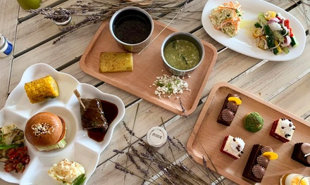 Saturday Brunch with Unlimited Soft or House Drinks for Up to Eight at Safi at 5* Ajman Saray Hotel (Up to 50% Off)